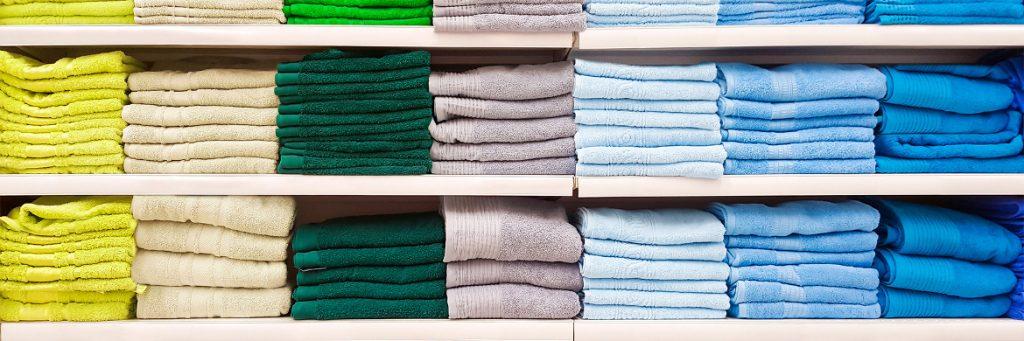 Big pile of colorful towels on shelf