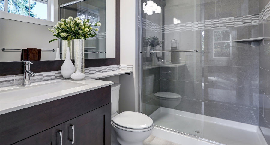 smart modern bathroom with large walk in shower