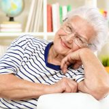Elderly lady relaxing at home